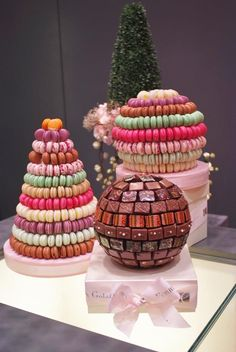 One of our favorite boutique displays! Macaroon pyramids and chocolates.