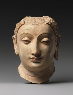 Head of Buddha [Afghanistan], about 5th-6th centuries, stucco with gesso & traces of paint, now in the Metropolitan Museum, New York
