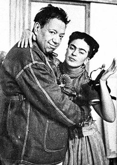 Frida Kahlo & Diego Rivera. Cool photo; they seem to have gas masks...