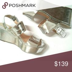"""Schutz Metallic Platform Wedges Shiny metallic mirrored silver finish platforms are really cute. Flatforms are so fashionable now, trending everwhere. Open toe. Worn once or twice, some minor blemishes, wrinkled one shoe. Sharp, crisp, overall great condition. 7.5-8.  Mirror finish metallic leather uppers  Rubber soles 3"""" heel, 2.5"""" platform  20% off bundles for one shipping charge or make me an offer I can't refuse. SCHUTZ Shoes Wedges"""