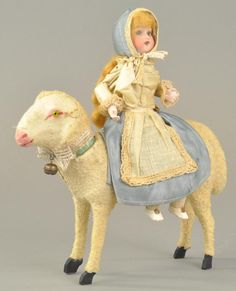 Lot # : 1779 - LITTLE GIRL ON LAMB CANDY CONTAINER. $1,121 2013