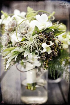 Flora Grubb is spectacular-what a bouquet! #LGLimitlessDesign #Contest greenery, white orchids and hydrangea, black privet berries, vibrant mosses, succulents and tillandsias, and silver leucadendron leaves; Flora Grubb