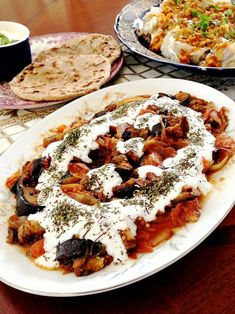 Afghan Banjan Borani Eggplant topped with organic homemade yogurt, garlic paste and dried mint leaves. #vegetarian #glutenfree
