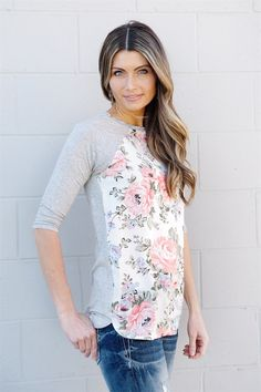 Our floral front tunics have been a favorite this Spring! These tops feature 3/4 raglan sleeves, floral print front, and grey sleeves and back. Dress them up or wear them more casual.