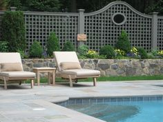 pool fence and rock retaining wall
