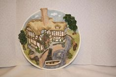 "David Winter Cottages wall plaque ""On the River Bank"" $18.50 **front of boat chipped/broken off. 8.5""D"