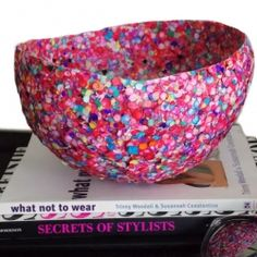 Use confetti, glue and a balloon to make a colorful and fun bowl.