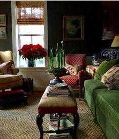 dark, dramatic walls, green velvet sofa, bamboo blinds