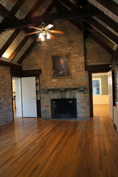 Amazing stone family room with vaulted, open beam ceiling.