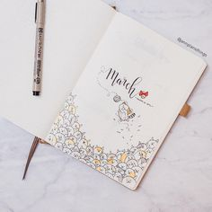 Bullet journal monthly cover page, March cover page, hand lettering, cat drawings, cat playing with yarn drawing, cute bullet journal drawing. | @jannplansthings