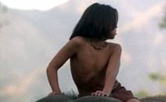 Mowgli on Hathi's back going back to his wolfpack after he was rescued by Baloo and Bagheera