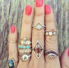 I love the two rings on the middle finger. A different twist on wedding band/engagement ring set: