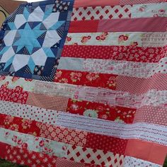 Last week I showed a pic of my American Flag quilt, and it was so boring it was driving me crazy. I'm liking it much better with this Swoon block