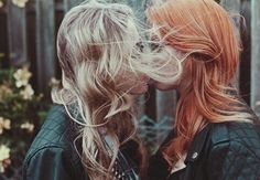 Kiss.contrasting hair colour makes for a natural photo