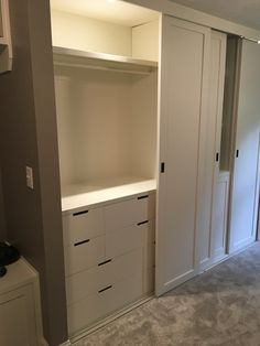 IKEA Nordli dressers within built-in closet, sliding ceiling mounted doors -- would like something like this where existing laundry room is for coats, additional storage