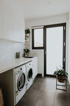 Gorgeous luxury laundry with marble brick splashback, large format grey floor tiles and loads of storage