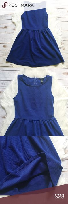 """Knit Sleeveless Dress Knit sleeveless dress. Royal blue. Round neck. 97% Polyester / 3% Spandex. Back zip about 16.5"""". Unlined. Measurements on one side when laid flat: Length about 31"""" from top of shoulder to hem. Waist hits about 14"""" from top of shoulder. Underarm to underarm about 14.5"""". Waist about 13.5"""" wide. Hem flares out to about 28.5"""". In excellent condition. Forever 21 Dresses Midi"""