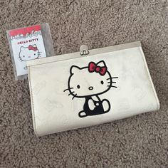 Sanrio Hello Kitty Big Clutch Wallet New with tags detached. Some stains on front as shown on last picture but its not that noticeable  ( I had it stored with other purses)  Sanrio Bags Clutches & Wristlets