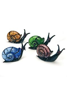They get their shimmering sheen from the real silver leaf that is encased in their jewel tone shells. Assortment may vary. Mosaic Glass, Fused Glass, Glass Beads, Pond Animals, Snail Craft, Glass Frog, Glass Figurines, Lampwork Beads, Oeuvre D'art