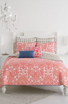 3819e9180d16 This gorgeous floral quilt in coral adds a vibrant and feminine touch to  the bedroom.