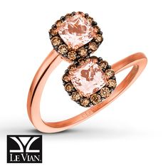Chocolate Diamonds® frame a pair of cushion-cut Peach Morganite™ gems; on each end of a swirl of 14K Strawberry Gold®