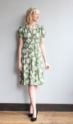 ~Gorgeous 1940s Silk Dress ~White floral print ~Pale green ~Side metal zipper ~Short puff sleeves  ❉ measurements:  fits like: Small bust: 35 waist: 27-28 hip: 41 sleeve: 9 shoulder: 14 shoulder to waist: 15 waist to hem: 26 length: 41  ❉ All measurements are taken in inches. Please ensure fit before purchasing. All sales are final. No returns or exchanges.  brand/maker: // material: Silk condition: Great! No issues known to note. cleaned and ready to wear. ❉ All items are vint...