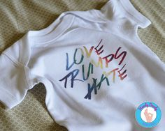 This rainbow-tastic tee shows that love always wins over hate. Our made-to-order shirt features the phrase Love Trumps Hate in rainbow lettering on a white onesie bodysuit or t-shirt. Be sure to review the size chart (see shop policies) to ensure you get the correct size. When in doubt, size up!  Due to monitor/display settings and/or dye lots, colors may vary slightly.  Please review shop policies before placing your order.  Do not use steam if ironing as it may cause colors to run…