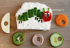 Caterpillar sandwich  -  made of bread, cream cheese, tomato and cucumber