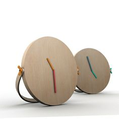 LOCK by Ivana Mannavola (Italy)LOCK is a solid oak clock that according to its needs, can be a wall clock or it can be placed on a surface, like floor or other support base. To ensure its support on a shelf, the handle of the clock is adjusted thanks to the wing screws, that confer further character and charm to the object. At the base of the dial, which will be directly in contact with the surface, a chamfer is useful to increase the grip on the shelf, in such a way that the clock does not…