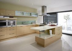 Love the style, island design and tops. Minimalist contemporary wooden kitchen cabinets.