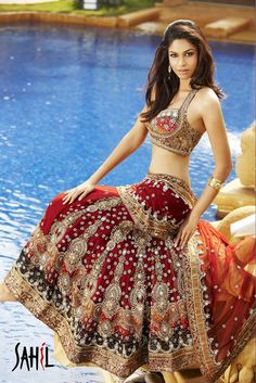 This all maroon bridal lehenga is a perfect combination of Style and tradition. The attached net dupatta with the banarasi halter blouse adds a modern touch to this traditional bridal outfit. Heavily embroidered with zardosi and Crystal work this intricate workmanship makes this outfit elegant and sensuous.