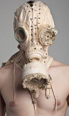 """Corset gas mask - saw this on """"Oddities"""" and I think it's SOO beautiful..adding a feminine touch to something perceived so negatively."""