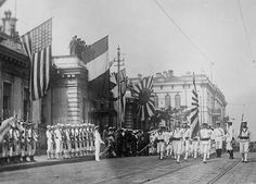 Allied troops stage a parade at Vladivostok that includes Japanese  and Americans. The Allies  provided a token presence on Russian soil while their ships arrived   with supplies  for  the White Russian troops  to help them defeat the  Red Army. However,  this  limited intervention failed as the White Russians    devolved into a disorganized jumble of rival factions that ultimately succumbed to the unified and highly motivated Red  Army led by  Trotsky.