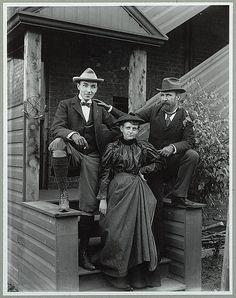 Frances Benjamin Johnston (front), with Mills Thompson (left) and Frank Phister, full-length portrait, posed on steps outside her studio.