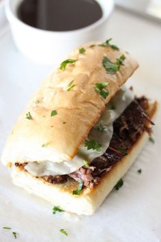 Instant Pot Pressure Cooker French Dip Sandwiches - Tender chunks of beef roast topped with melty cheese on a toasted garlic bread roll!