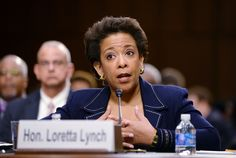 """Attorney General nominee Loretta Lynch responded to waves of attacks against her predecessor with calm empathy Wednesday, telling a Republican questioner that """"No, I am not Eric Holder."""""""