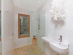 Striking minimalist bathroom. Bet it's easy to keep clean.