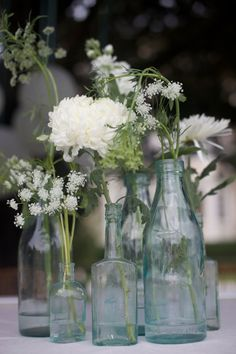 more flowers in bottles
