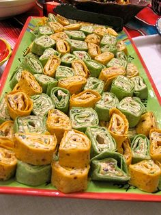 Mexican Roll-ups  1 (8 ounce) package cream cheese, softened  1/3 cup mayonaise (I've used sour cream with ranch dip poweder or use that flavored mayo)  1 (4 ounce) can diced green chiles, chopped and drained  1 (2.25 ounce) can black olives, drained and chopped  6 green onions, chopped  1/2 cup salsa  About 3/4 cup finely shredded Mexican blend cheese  8 (10 in) flour tortillas