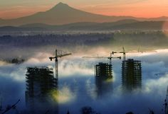 The sun rises on #MtHood and #Portland's South Waterfront.