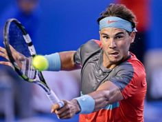 Rafael Nadal of Spain makes a backhand return to Stanislas Wawrinka of Switzerland. (Rick Rycroft/AP)