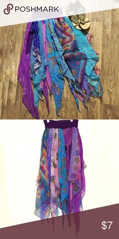 """Asymmetrical Boho-fashion Scarf Skirt Asymmetrical Boho-fashion Scarf Skirt. This piece is multiple scarves in purple and blues with a purple elastic waistband. The waistband is 10"""" across but can stretch to 19"""". There is a purple underslip that goes to mid-thigh to prevent exposure. Skirts Asymmetrical"""