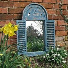 rush blue shuttered mirror garden wall art