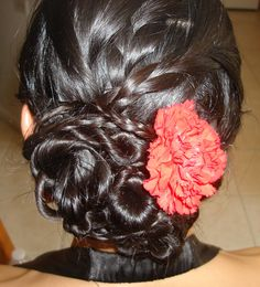 Bun made out of braids and twist and a real flower to top it off www.lbgorgeous.com