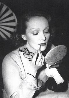 Marlene Dietrich, touching up her Makeup, on the set of 'The Garden of Allah', 1936.