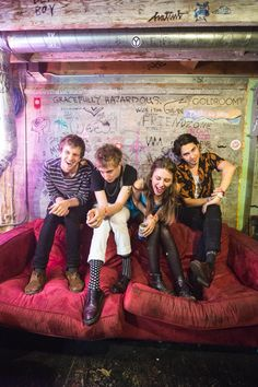 Wolf Alice comes across as individual and arty. Slightly alternative by sitting by a graffitied wall                                                                                                                                                                                 More