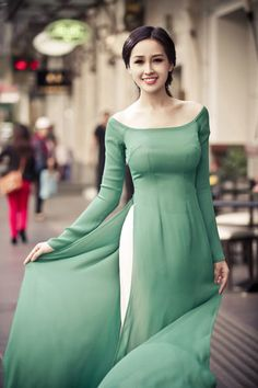 Ao Dai Dresses Green Light Boat Neck Chiffon Dress is made by chiffon and satin, boat neck , long sleeves, long lap. The color is plain green light Vietnamese Traditional Dress, Vietnamese Dress, Traditional Dresses, Pakistani Dresses, Indian Dresses, Indian Outfits, Chiffon Dress, Fashion Dresses, Party Dresses