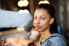 Make up Artist Lisa Houghton creates the first look on model Jasmine Tookes – all about a strong brow and subtle contouring with highlighter.