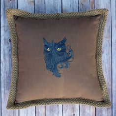 Fearsome Owl on a brown cotton pillow by mycousinmadeit on Etsy