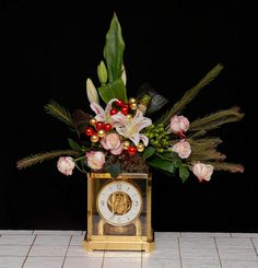 Flower Arrangements On Clock/Hourglass for New Year from   Rittners Floral School  Boston, MA  www.floralschool.com  www.facebook.com/floralschool